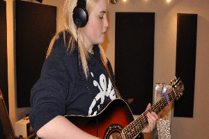 girl playing guitar at airdrie guitar lessons